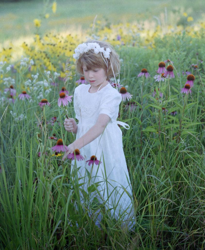 Emma picking flowers